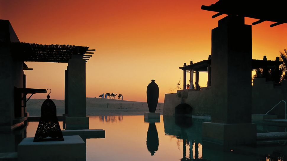 Special Guide Special Guide to Visit Dubai 002825 08 pool with camels sunset