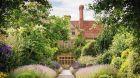 Exterior with lush gardens