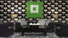 See more information about The Soho Hotel patterned wallpaper sitting area