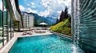 See more information about Tschuggen Grand Hotel Arosa Exterior pool with mountians