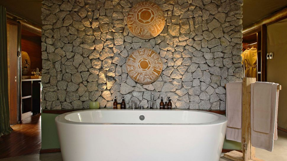 Bathtub with stone wall & Ngala Tented Camp Kruger National Park Limpopo