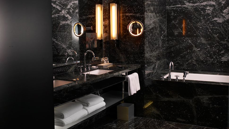 The hazelton hotel ontario canada for Dark bathroom wallpaper
